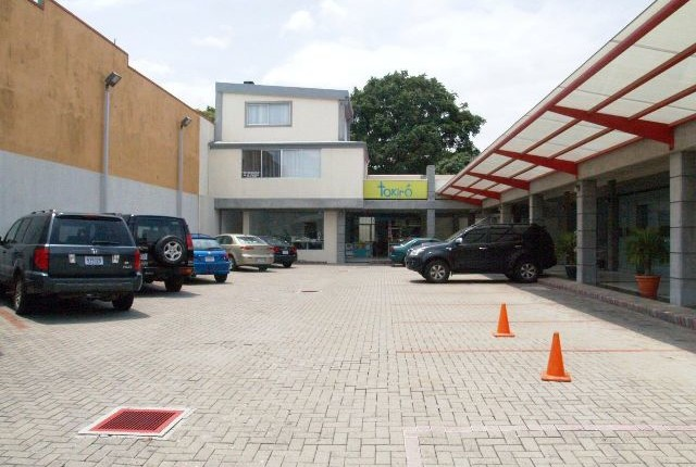 CC 424  FOR SALE By Multiplaza main Road  to Guachipelin a small mall
