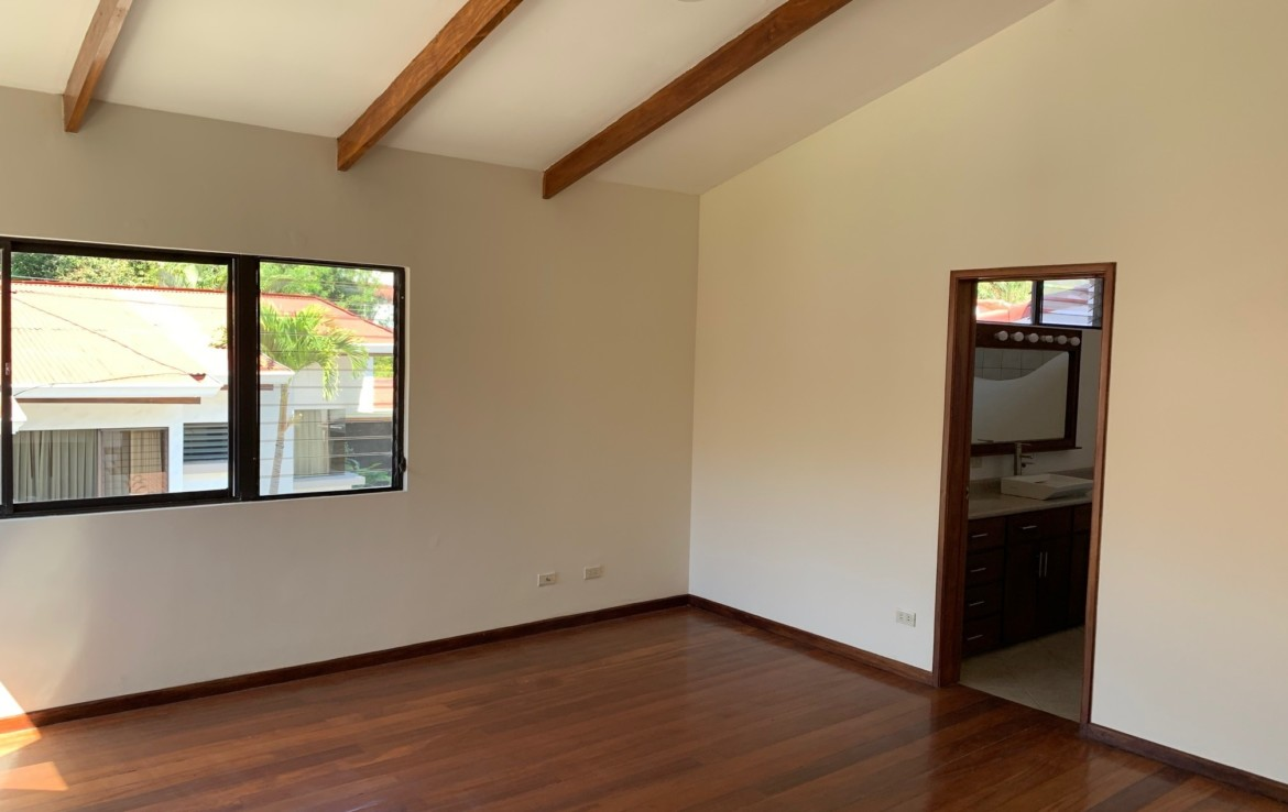 C 3037 House in condominium. A charming oasis of tranquility a few steps from the Country Club in Escazu.